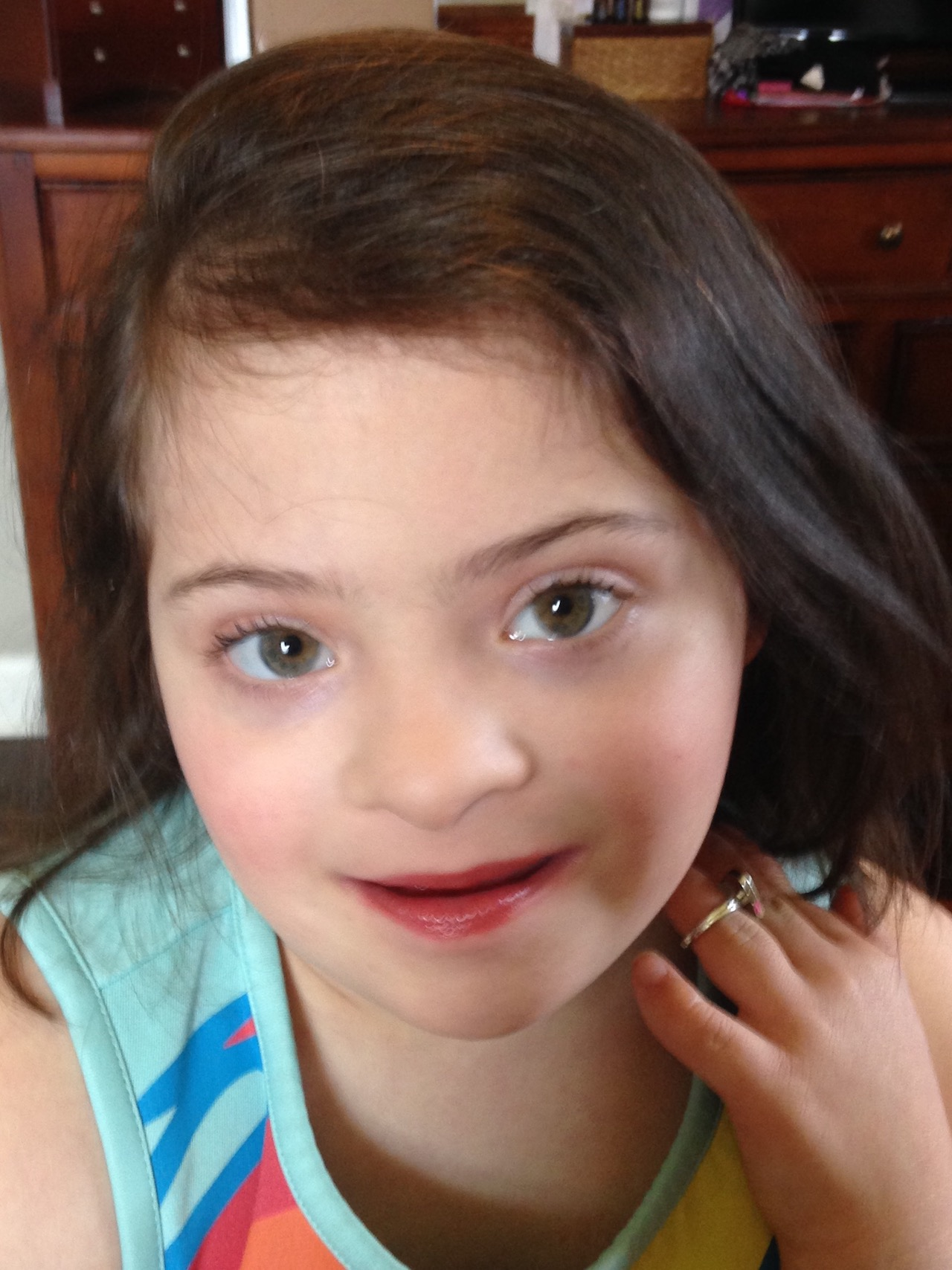 Girl with Down syndrome wearing makeup