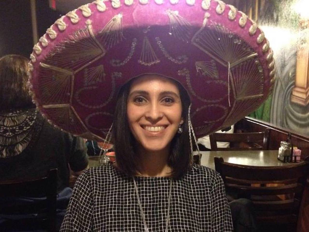 me wearing a pink sombrero at a Mexican restaurant